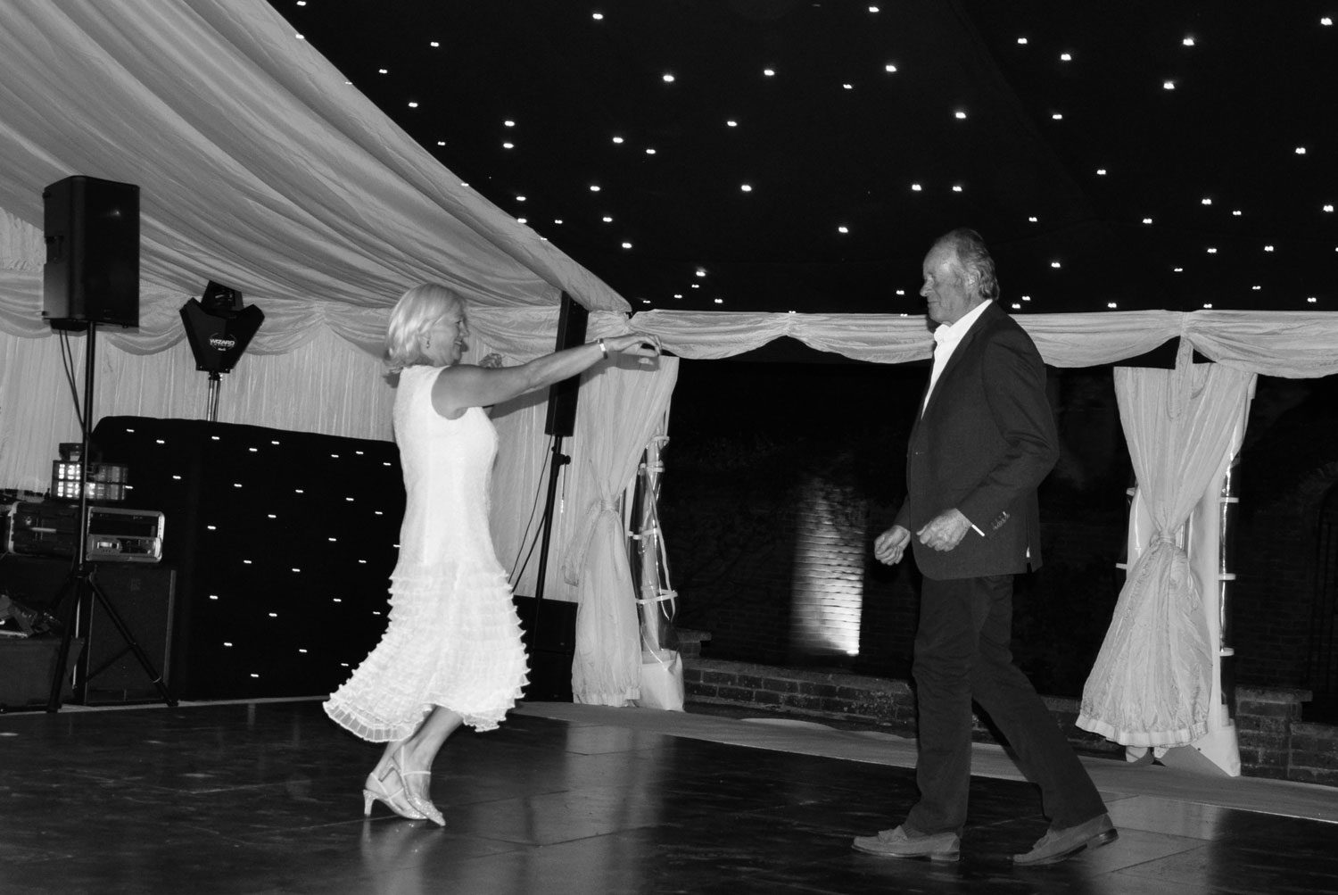 Bride and Groom dancing (black & white photo)